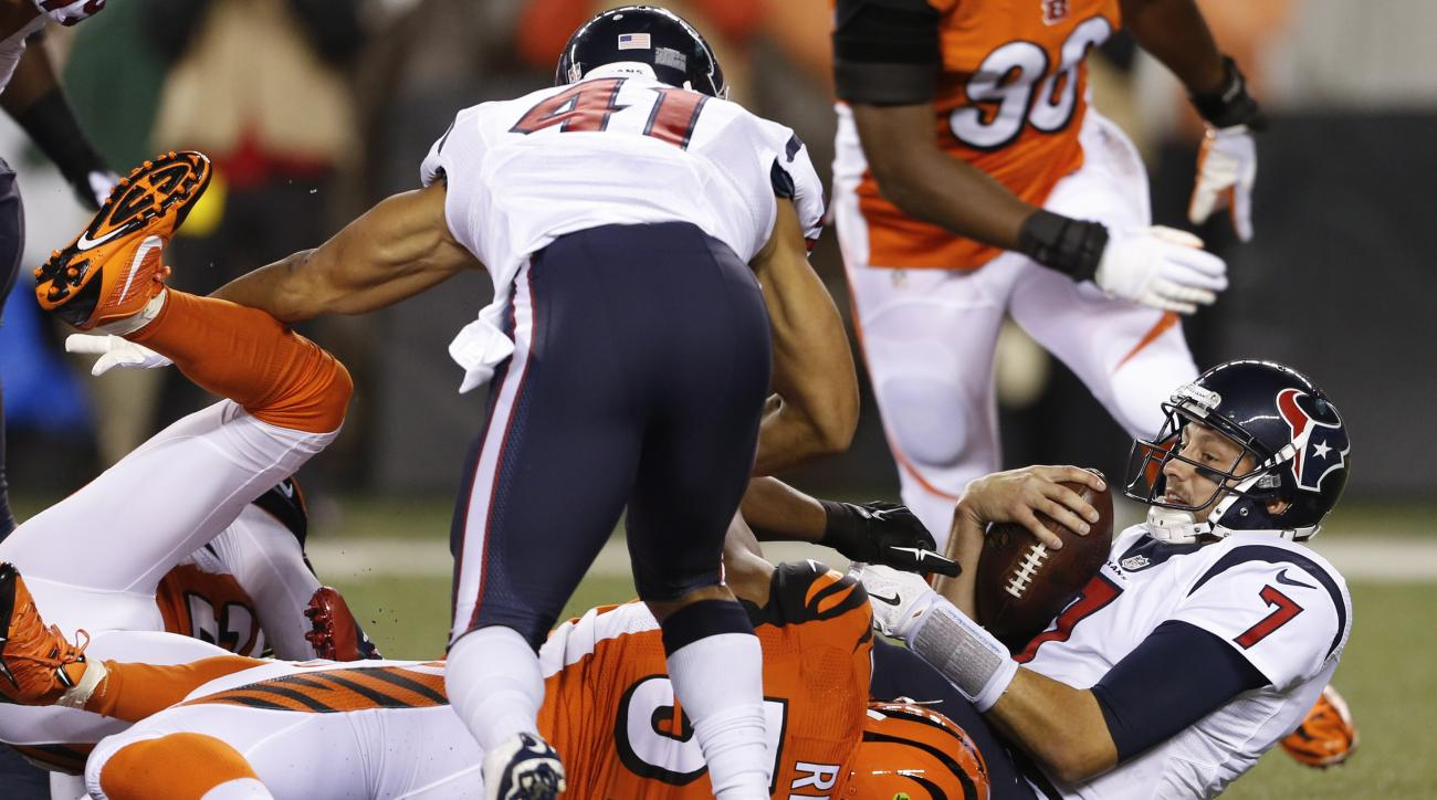 Houston Texans quarterback Brian Hoyer (7) is sacked by Cincinnati Bengals outside linebacker Vincent Rey (57) in the first half of an NFL football game in Cincinnati, Monday, Nov. 16, 2015.  (AP Photo/Gary Landers)