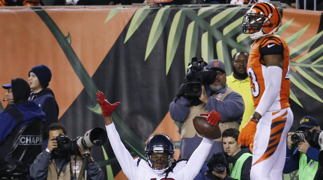 Houston Texans wide receiver DeAndre Hopkins (10) celebrates after scoring a touchdown as Cincinnati Bengals strong safety George Iloka (43) stands to the side in the second half of an NFL football game in Cincinnati, Monday, Nov. 16, 2015.  (AP Photo/Fra