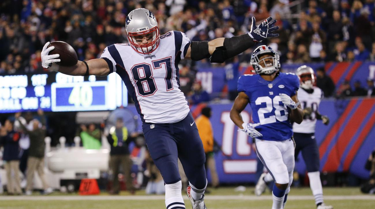 FILE - In this Nov. 15, 2015, file photo, New England Patriots' Rob Gronkowski (87) scores a touchdown in front of New York Giants' Jayron Hosley (28) during the second half of an NFL football game in East Rutherford, N.J. A last-second field goal keeps t