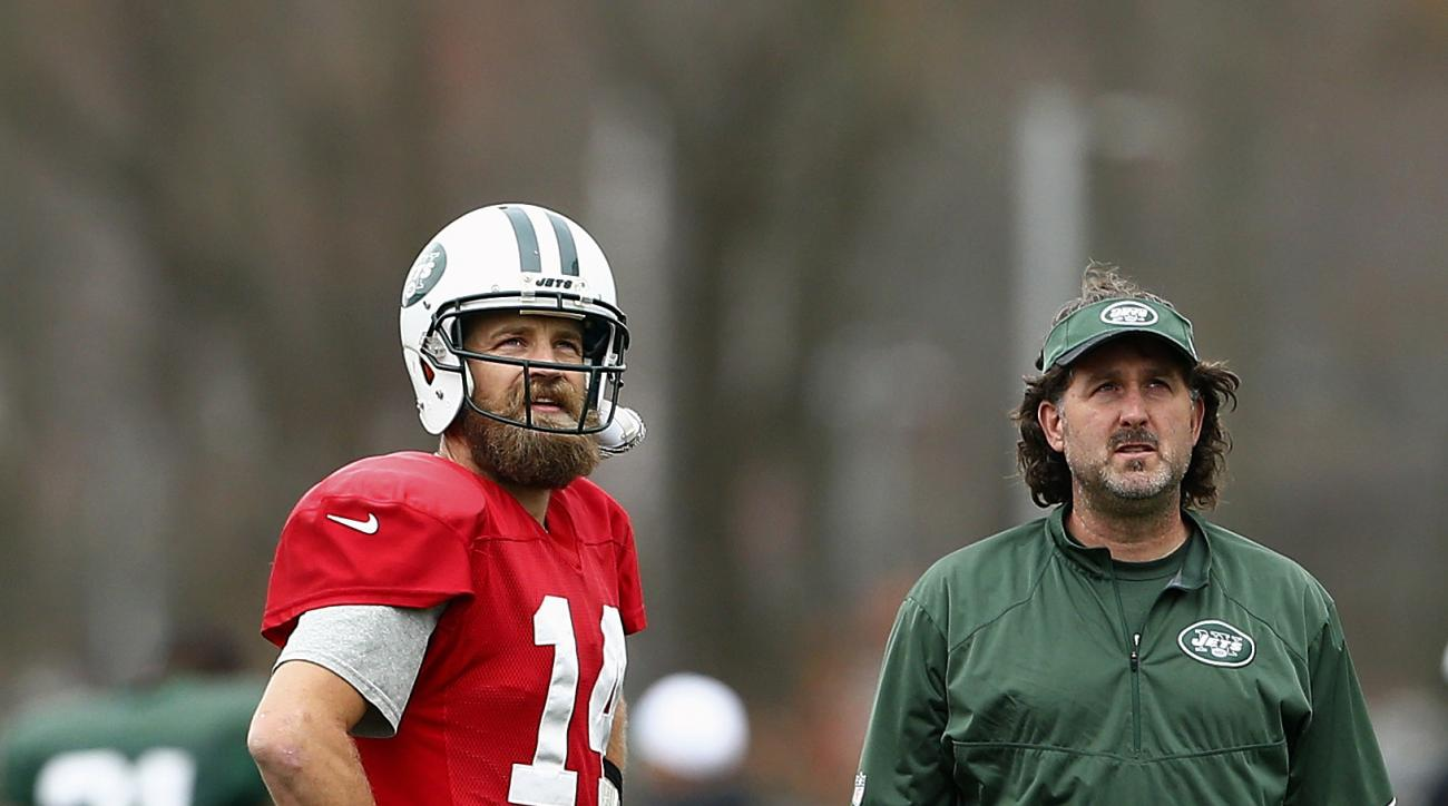 New York Jets quarterback Ryan Fitzpatrick (14) talks with team trainer John Mellody during practice at the team's NFL football training facility, Wednesday, Nov. 18, 2015, in Florham Park, N.J. (AP Photo/Rich Schultz)