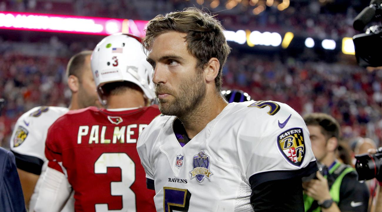 FILE - In this Oct. 26, 2015, file photo, Baltimore Ravens quarterback Joe Flacco (5) walks away after greeting Arizona Cardinals quarterback Carson Palmer (3) at midfield after an NFL football gamein Glendale, Ariz. With a 2-7 record and the playoffs out