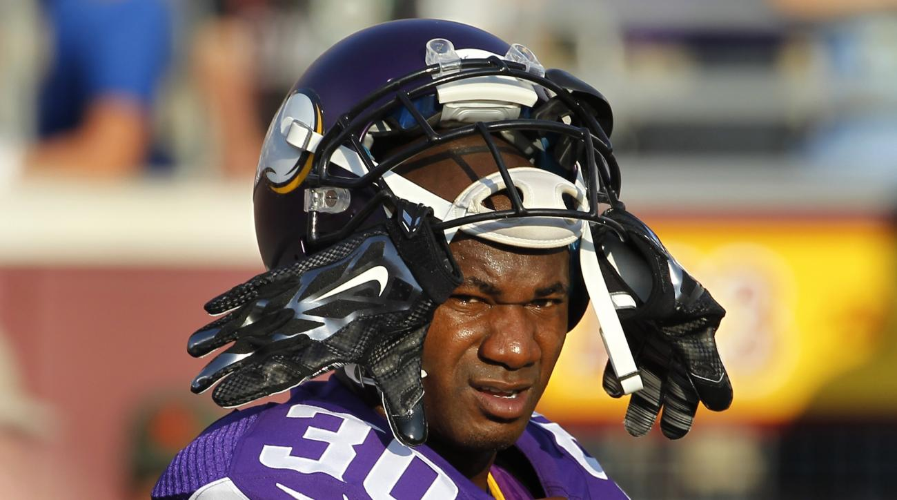 FILE - In this Aug. 15, 2015, file photo, Minnesota Vikings defensive back Terence Newman (30) watches during an preseason NFL football game against the Tampa Bay Buccaneers at TCF Bank Stadium in Minneapolis. Terrence Newman followed Mike Zimmer to Minne