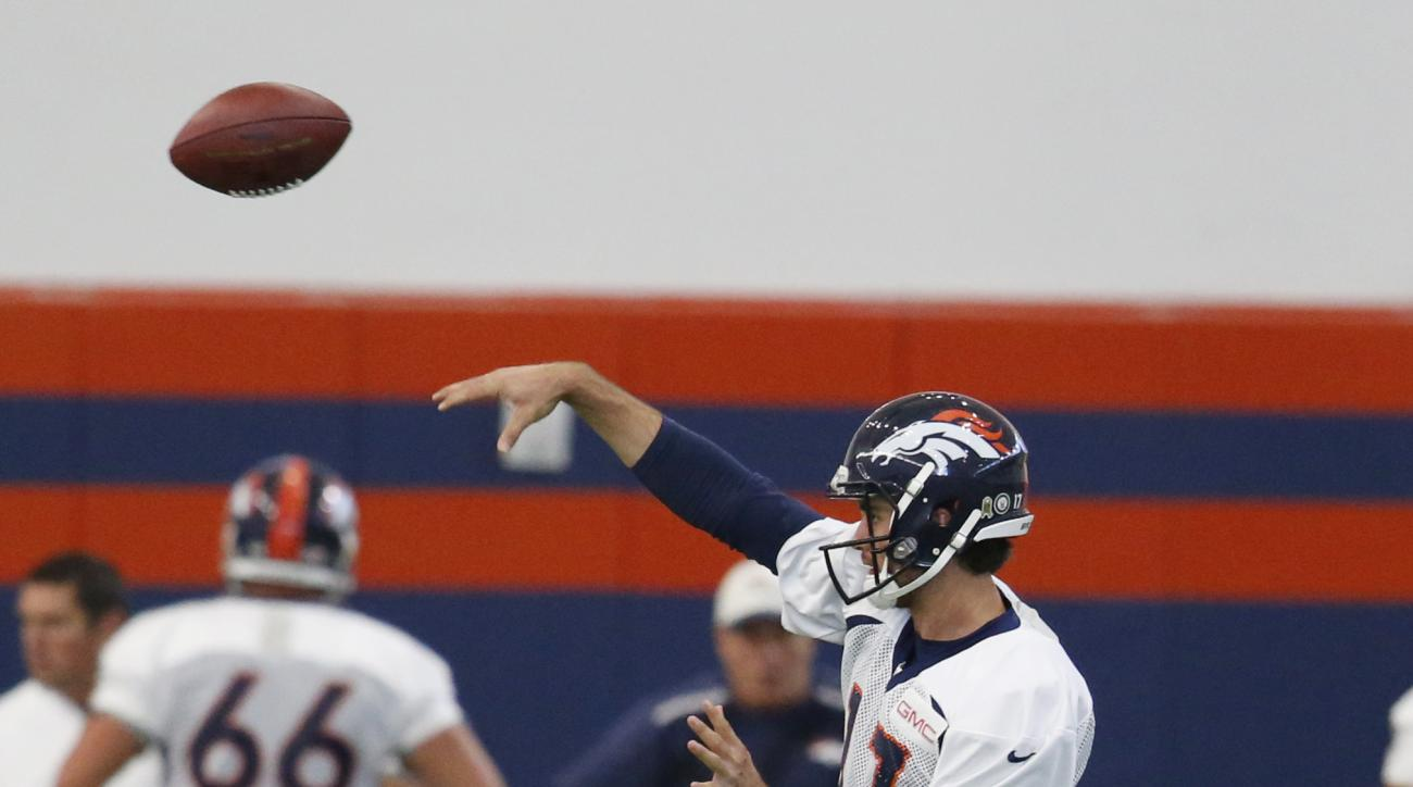 Denver Broncos quarterback Brock Osweiler throws a pass during a practice session at the team's headquarters Wednesday, Nov. 18, 2015, in Englewood, Colo. (AP Photo/David Zalubowski)