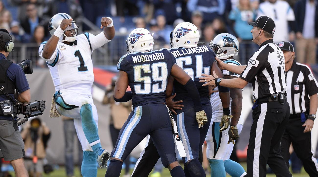 FILE - In this Nov. 15, 2015, file photo, Carolina Panthers quarterback Cam Newton (1) dances in front of Tennessee Titans defenders Wesley Woodyard (59) and Avery Williamson (54) after Newton scored a touchdown on a 2-yard run in the second half of an NF