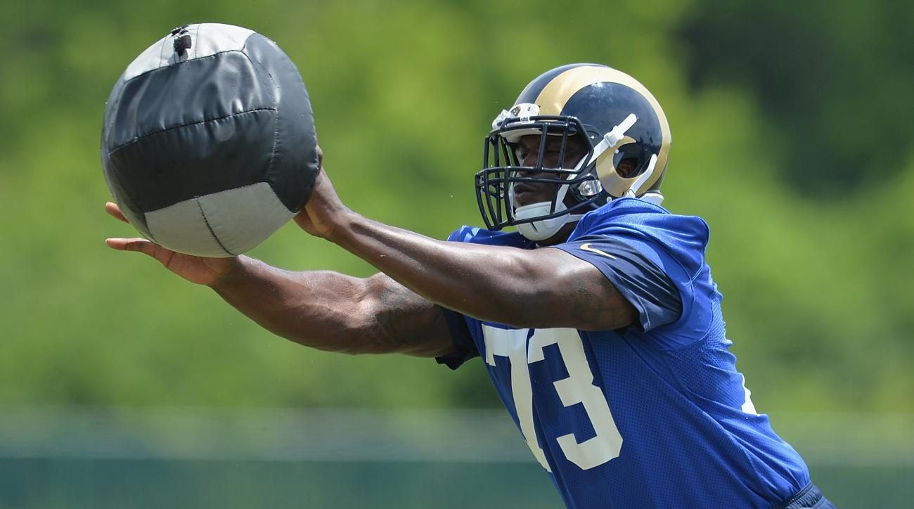 FILE - In this June 11, 2015,  file photo, St. Louis Rams offensive lineman Greg Robinson works on a drill during an NFL football organized team activity in St. Louis. Penalties have been a big problem for Robinson but the second overall pick of last year