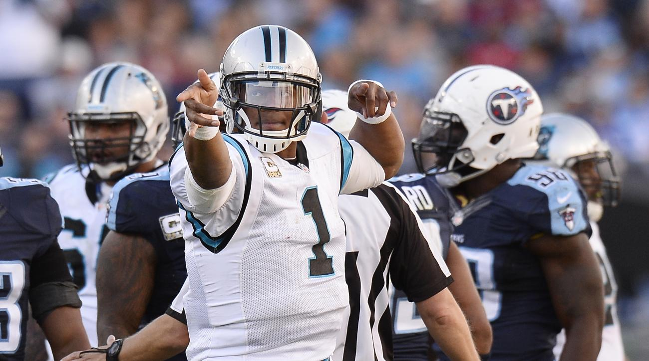 In this photo taken Nov. 15, 2015, Carolina Panthers quarterback Cam Newton (1) celebrates a first down against the Tennessee Titans in the second half of an NFL football game in Nashville, Tenn. The Washington Redskins, who pay the Panthers in Charlotte