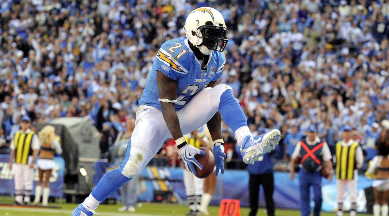 FILE - In this Nov. 19, 2009, file photo, San Diego Chargers running back LaDainian Tomlinson celebrates atouchdown during an NFL football game against the Kansas City Chiefs in San Diego. Tomlinson's No. 21 will be retired at halftime of Sunday's game ag
