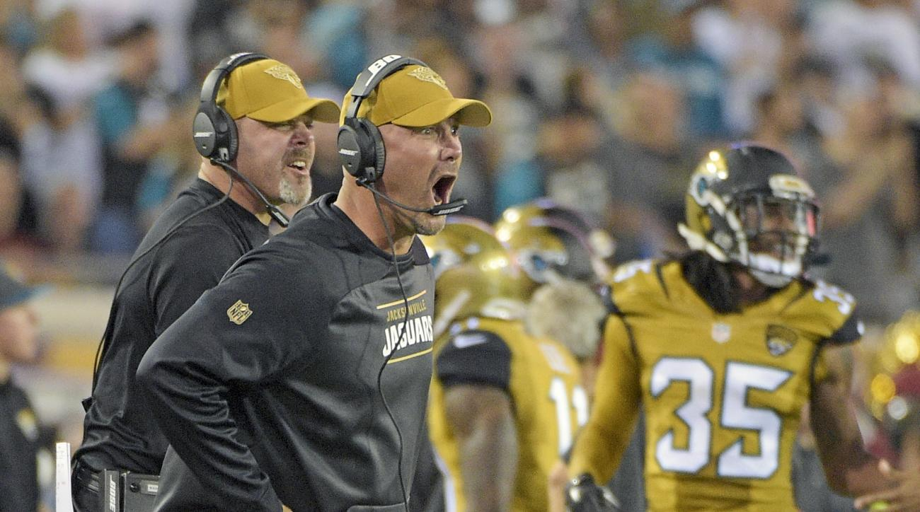 Jacksonville Jaguars head coach Gus Bradley disputes a call by officials during the first half of an NFL football game against the Tennessee Titans in Jacksonville, Fla., Thursday, Nov. 19, 2015.(AP Photo/Phelan M. Ebenhack)