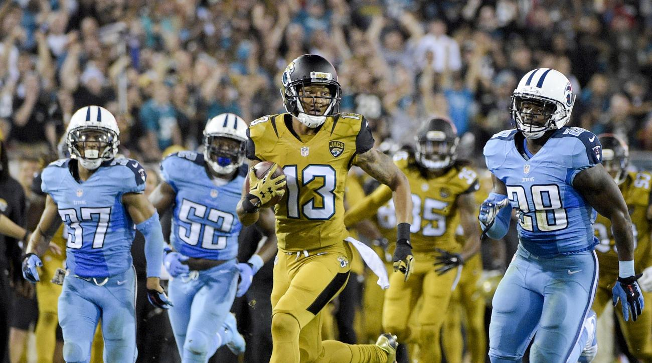 Jacksonville Jaguars' Rashad Greene runs back a punt return past Tennessee Titans cornerback Cody Riggs (37), Steven Johnson (52) and Marqueston Huff (28) during the second half of an NFL football game in Jacksonville, Fla., Thursday, Nov. 19, 2015.(AP Ph