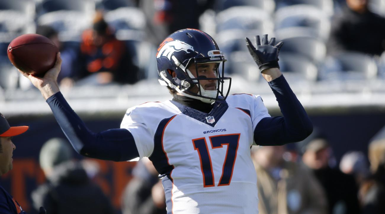 Denver Broncos quarterback Brock Osweiler (17) warms up before an NFL football game against the Chicago Bears, Sunday, Nov. 22, 2015, in Chicago. (AP Photo/Charles Rex Arbogast)