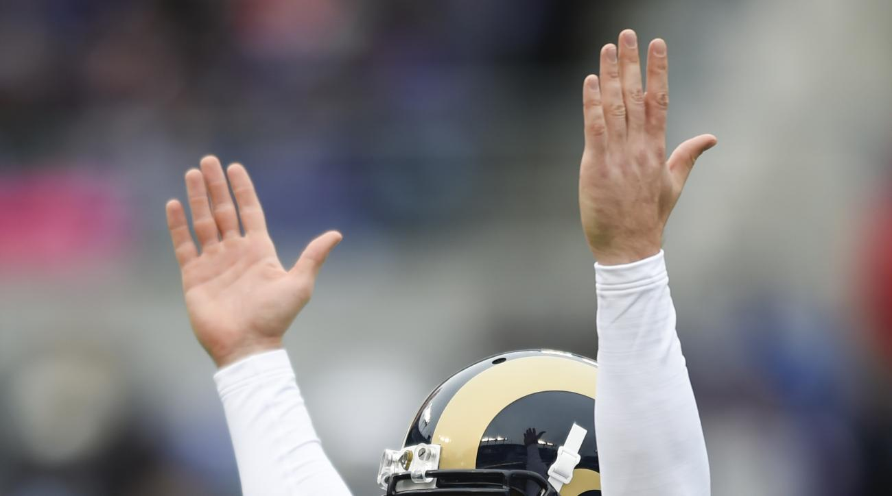 St. Louis Rams quarterback Case Keenum (17) celebrates running back Todd Gurley (30) touchdown during the first half of an NFL football game against the Baltimore Ravens in Baltimore, Sunday, Nov. 22, 2015. (AP Photo/Gail Burton)
