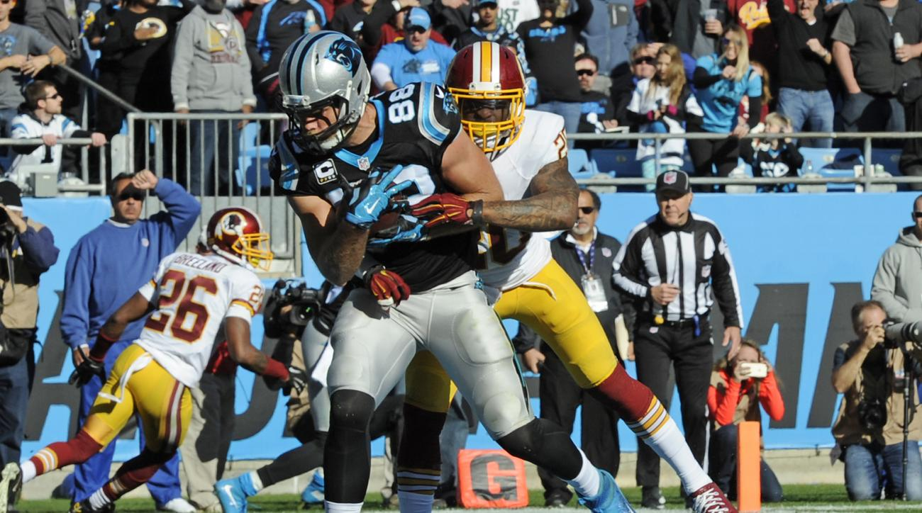 Carolina Panthers' Greg Olsen (88) catches a touchdown pass against Washington Redskins' Jeron Johnson (20) in the first half of an NFL football game in Charlotte, N.C., Sunday, Nov. 22, 2015. (AP Photo/Mike McCarn)