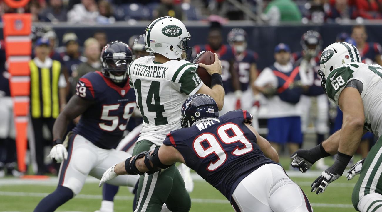 New York Jets quarterback Ryan Fitzpatrick (14) is sacked by Houston Texans defensive end J.J. Watt (99) during the first half of an NFL football game, Sunday, Nov. 22, 2015, in Houston. (AP Photo/David J. Phillip)