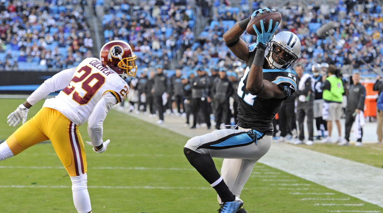 Carolina Panthers' Devin Funchess (17) catches a touchdown pass as Washington Redskins' Chris Culliver (29) defends in the second half of an NFL football game in Charlotte, N.C., Sunday, Nov. 22, 2015. (AP Photo/Mike McCarn)