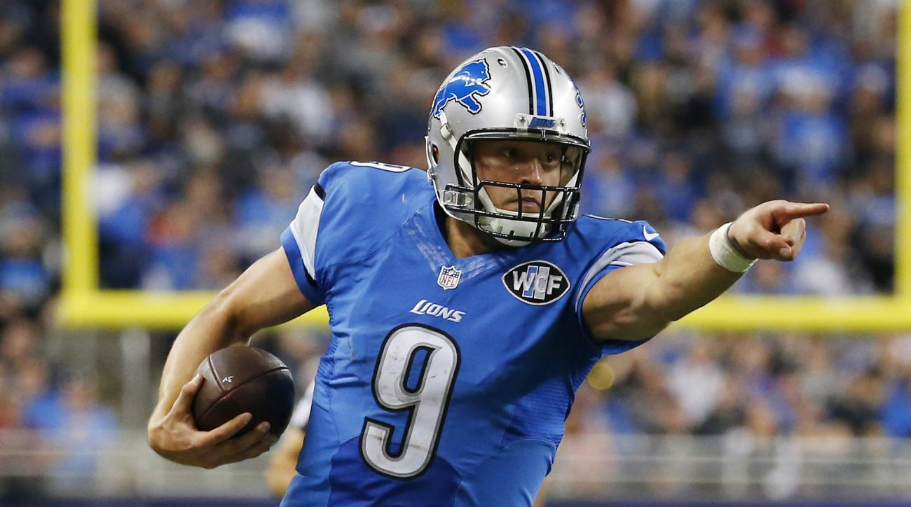 Detroit Lions quarterback Matthew Stafford (9) points as he scrambles during the second half of an NFL football game against the Oakland Raiders, Sunday, Nov. 22, 2015, in Detroit. (AP Photo/Paul Sancya)
