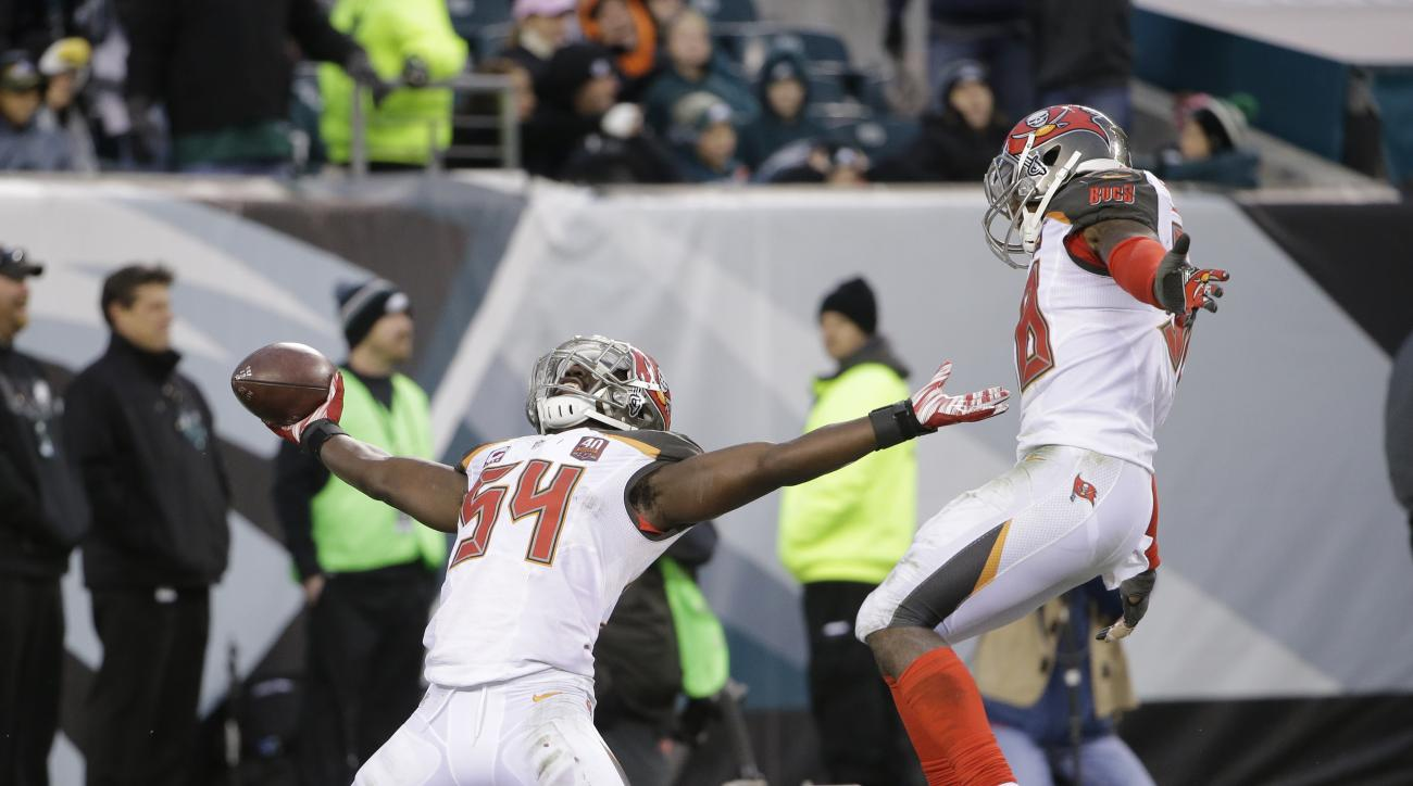 Tampa Bay Buccaneers' Lavonte David, left, and Kwon Alexander celebrate after David intercepted a pass and scored a touchdown during the second half of an NFL football game against the Philadelphia Eagles, Sunday, Nov. 22, 2015, in Philadelphia. (AP Photo