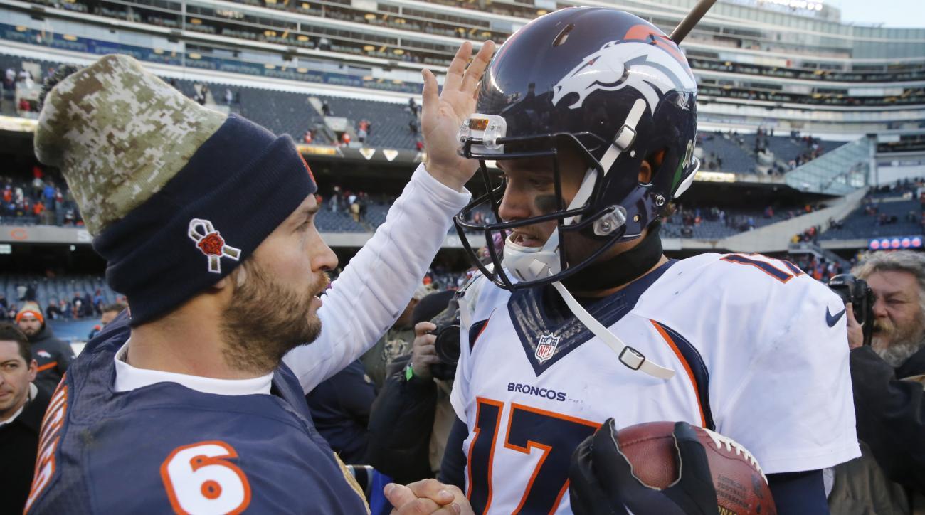 Chicago Bears quarterback Jay Cutler (6) talks to Denver Broncos quarterback Brock Osweiler (17) after an NFL football game, Sunday, Nov. 22, 2015, in Chicago. The Broncos won 17-15. (AP Photo/Charles Rex Arbogast)