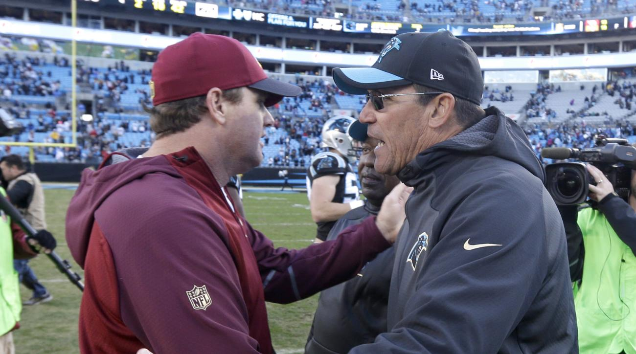 Carolina Panthers head coach Ron Rivera, right, greets Washington Redskins head coach Jay Gruden, left, after an NFL football game in Charlotte, N.C., Sunday, Nov. 22, 2015. The Panthers won 44-16. (AP Photo/Bob Leverone)