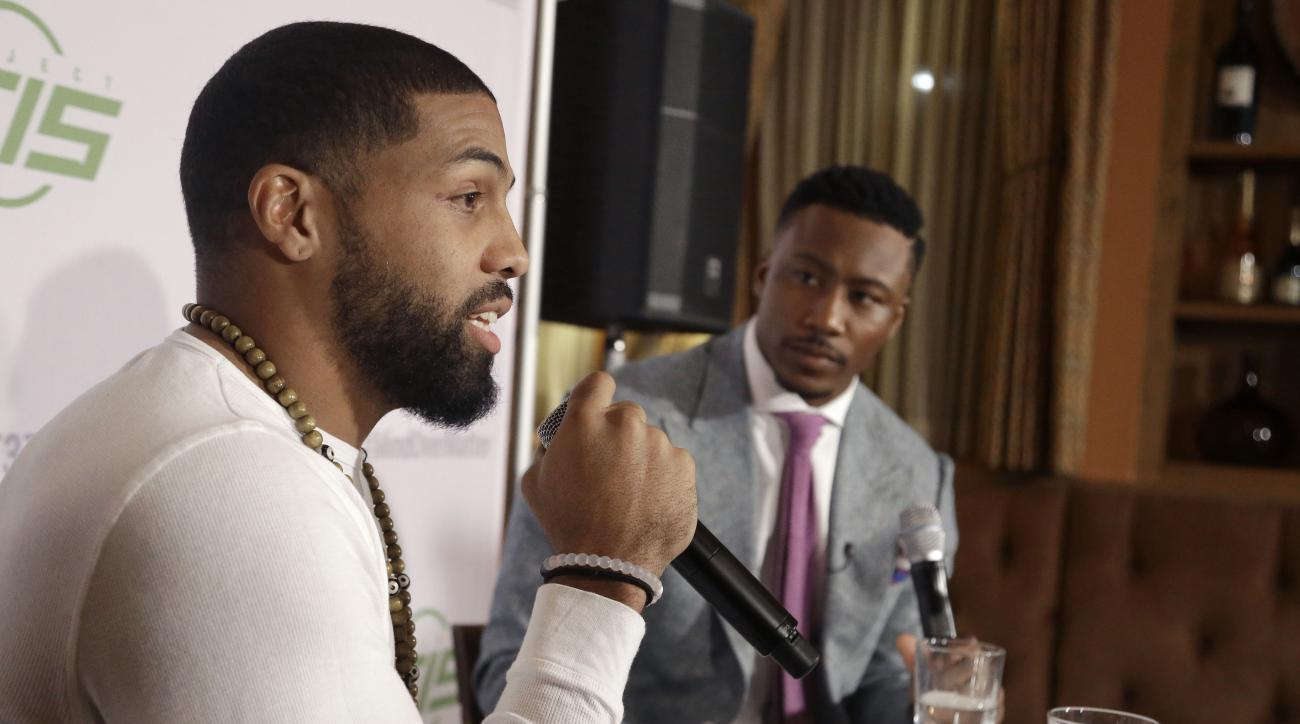 In this Saturday, Nov. 21, 2015, photo, Houston Texans running back Arian Foster, left, and New York Jets receiver Brandon Marshall talk about overcoming mental health issues in Houston. Foster has joined Marshall's PROJECT 375, a nonprofit organization d