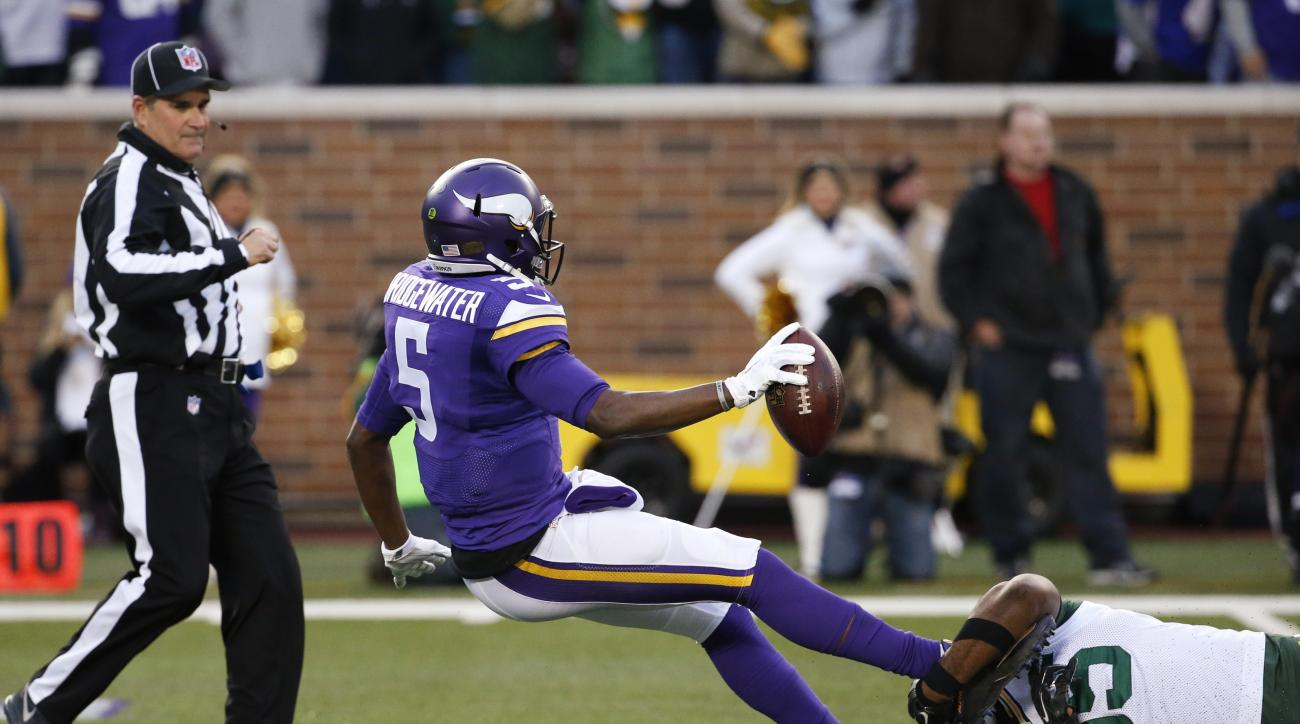 Minnesota Vikings quarterback Teddy Bridgewater (5) is sacked by Green Bay Packers defensive end Datone Jones (95) during the first half of an NFL football game in Minneapolis, Sunday, Nov. 22, 2015. (AP Photo/Ann Heisenfelt)