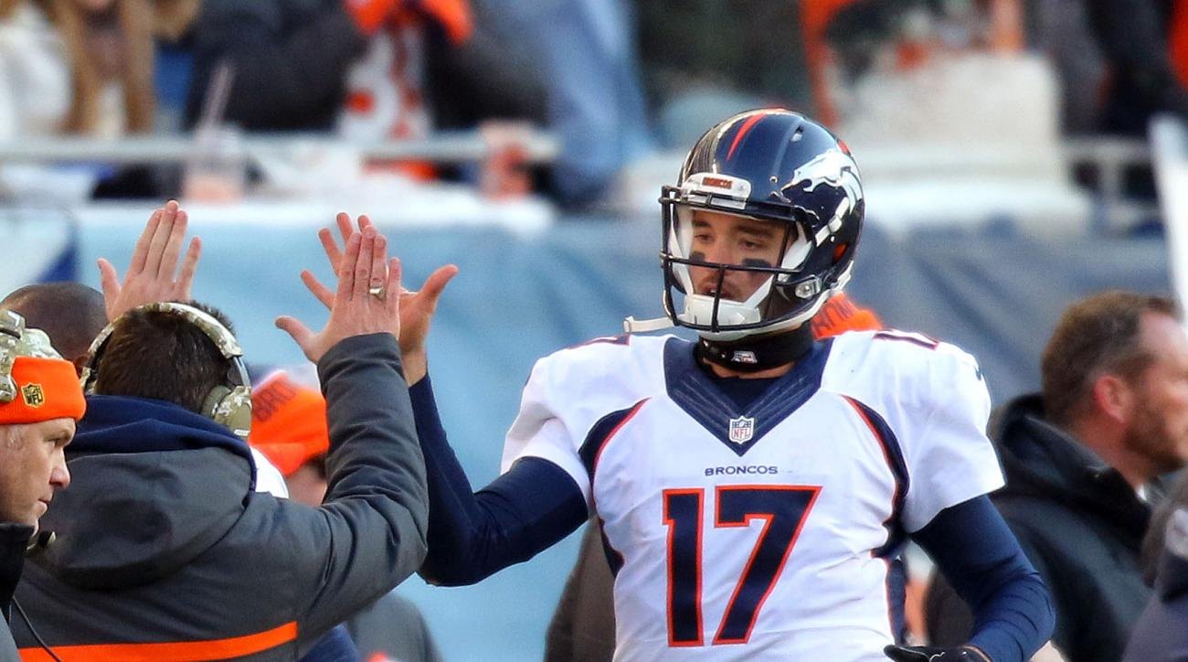 Denver Broncos quarterback Brock Osweiler gets high-fives after scoring during the second half of NFL football game against the Chicago Bears, Sunday, Nov. 22, 2015, in Chicago. (Steve Lundy/Daily Herald via AP) MANDATORY CREDIT; MAGS OUT