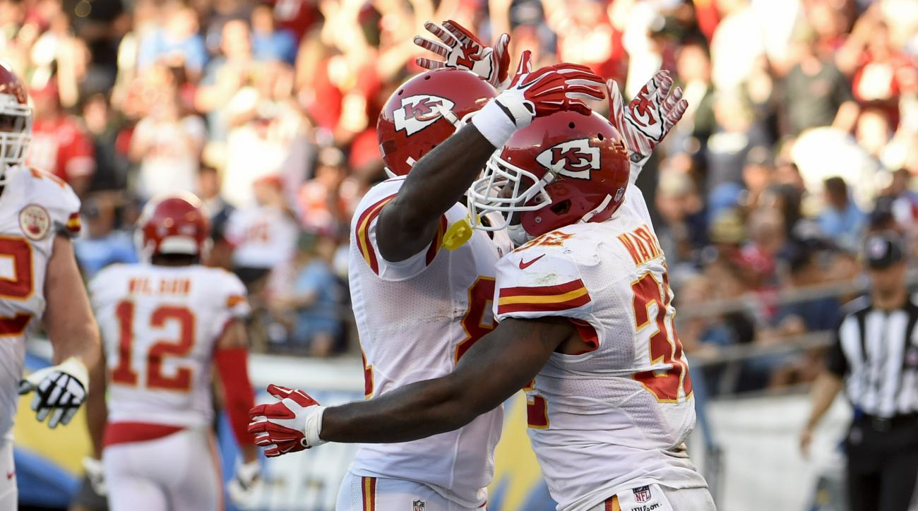Kansas City Chiefs running back Spencer Ware, right, celebrates with cornerback Marcus Cooper after scoring a touchdown during the second half of an NFL football game against the San Diego Chargers on Sunday, Nov. 22, 2015, in San Diego. (AP Photo/Denis P