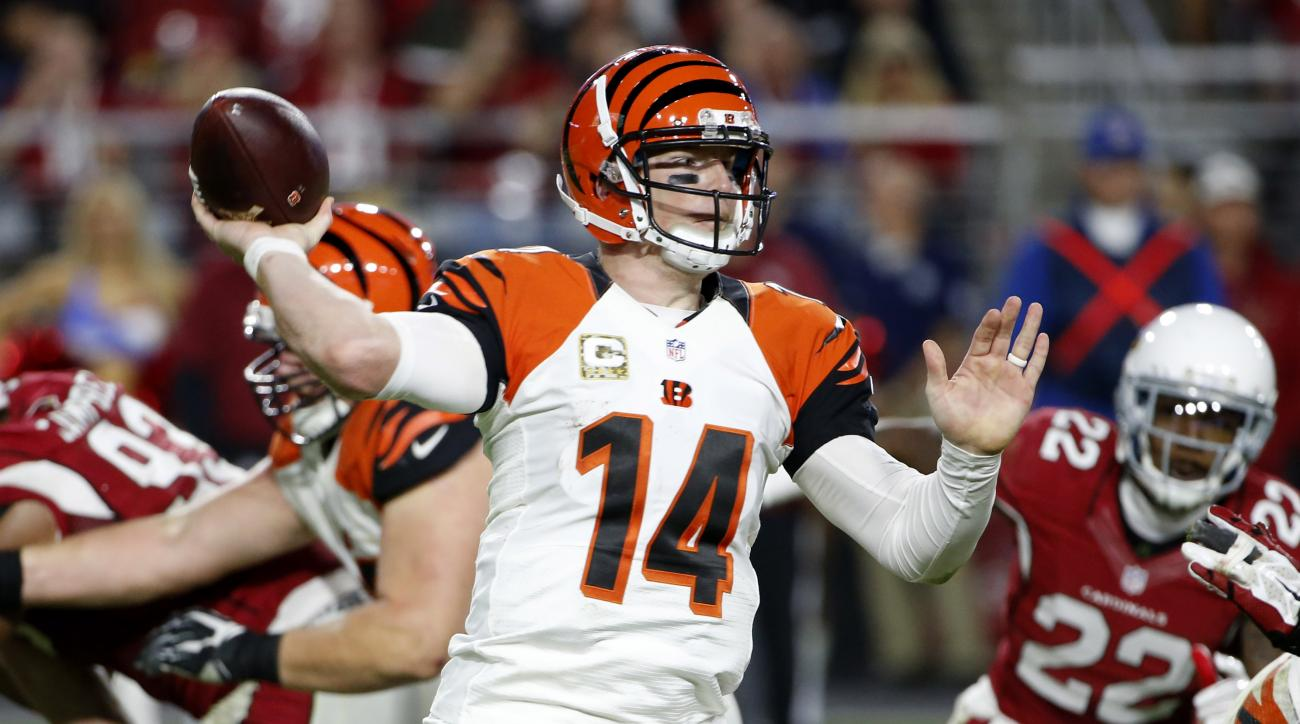 Cincinnati Bengals quarterback Andy Dalton (14) makes a throw against the Arizona Cardinals during the second half of an NFL football game, Sunday, Nov. 22, 2015, in Glendale, Ariz. (AP Photo/Ross D. Franklin)