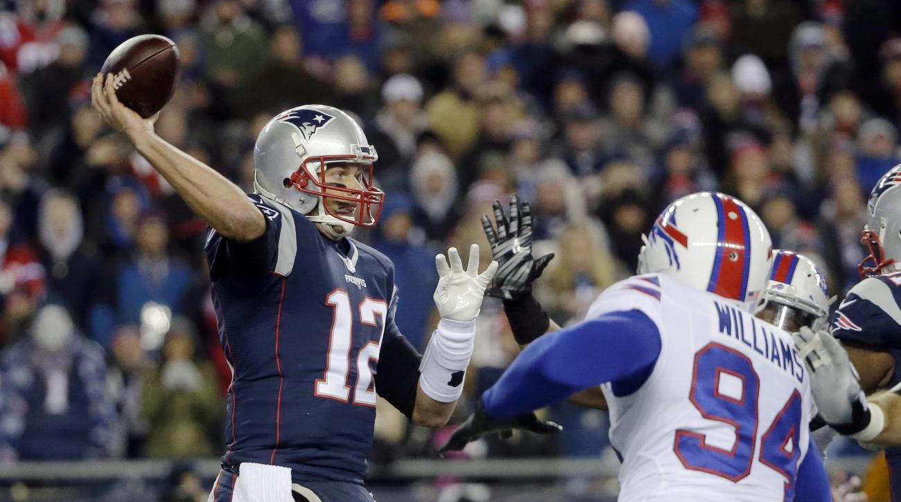 New England Patriots quarterback Tom Brady (12) passes over Buffalo Bills defensive end Mario Williams (94) in the first half of an NFL football game Monday, Nov. 23, 2015, in Foxborough, Mass. (AP Photo/Steven Senne)