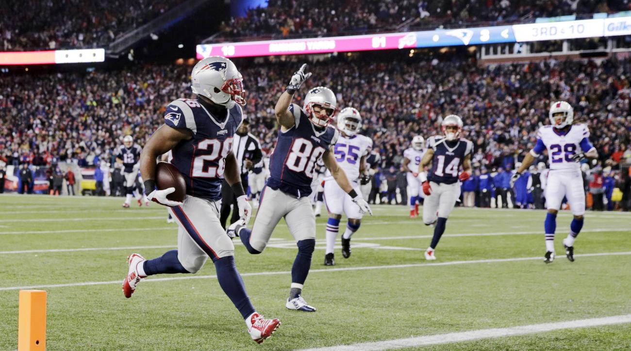 New England Patriots running back James White (28) scores a touchdown as teammate Danny Amendola (80) celebrates in the first half of an NFL football game against the Buffalo Bills, Monday, Nov. 23, 2015, in Foxborough, Mass. (AP Photo/Charles Krupa)