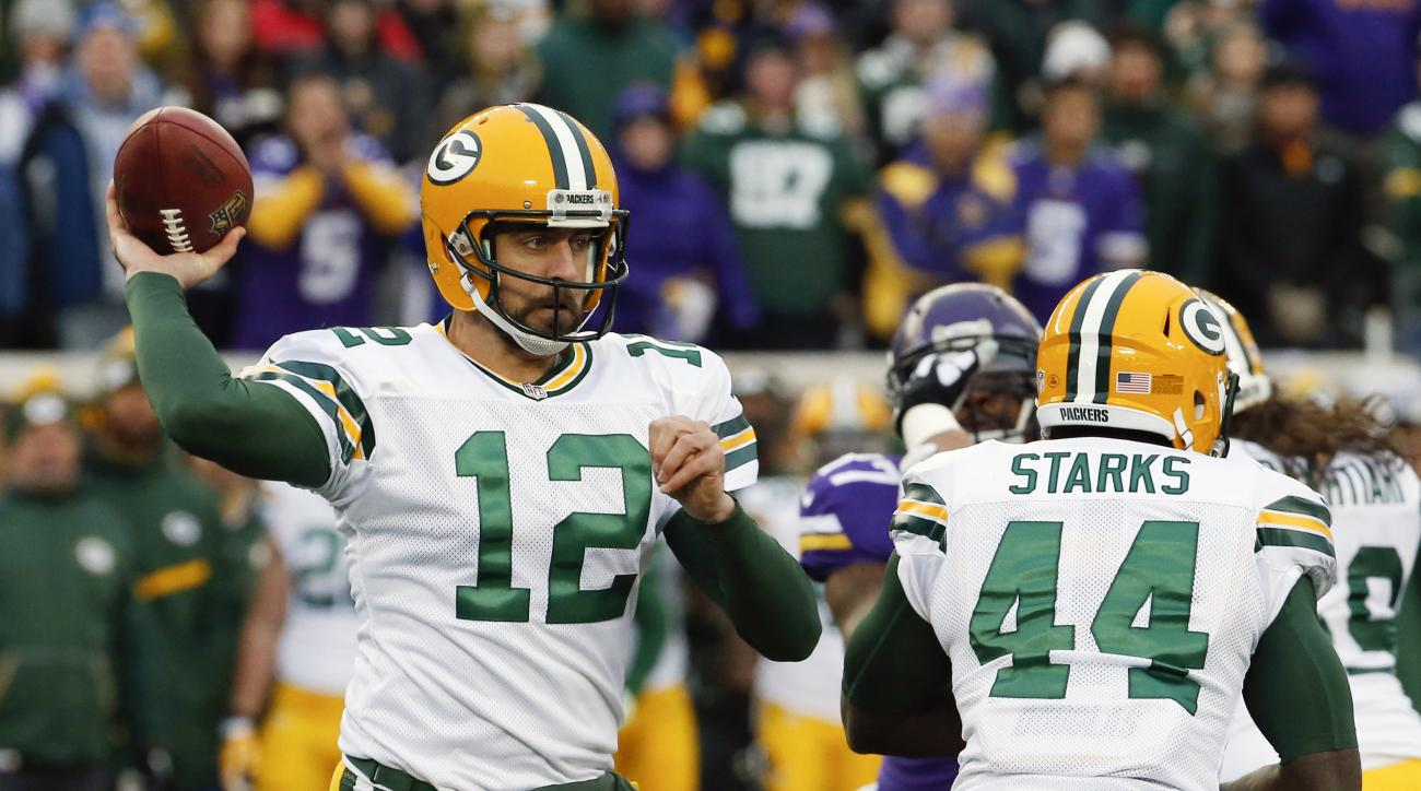 FILE - In this Sunday, Nov. 22, 2015. file photo, Green Bay Packers quarterback Aaron Rodgers (12) throws against the Minnesota Vikings during the first half of an NFL football game in Minneapolis. Packers quarterback Aaron Rodgers is looking forward to t
