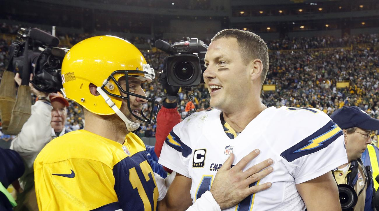 FILE - In this Oct. 18, 2015, file photo, Green Bay Packers' Aaron Rodgers, left, talks with San Diego Chargers' Philip Rivers (17) following a 27-20 Packers win in an NFL football game, in Green Bay, Wis. The 32 nominees for the second annual Art Rooney