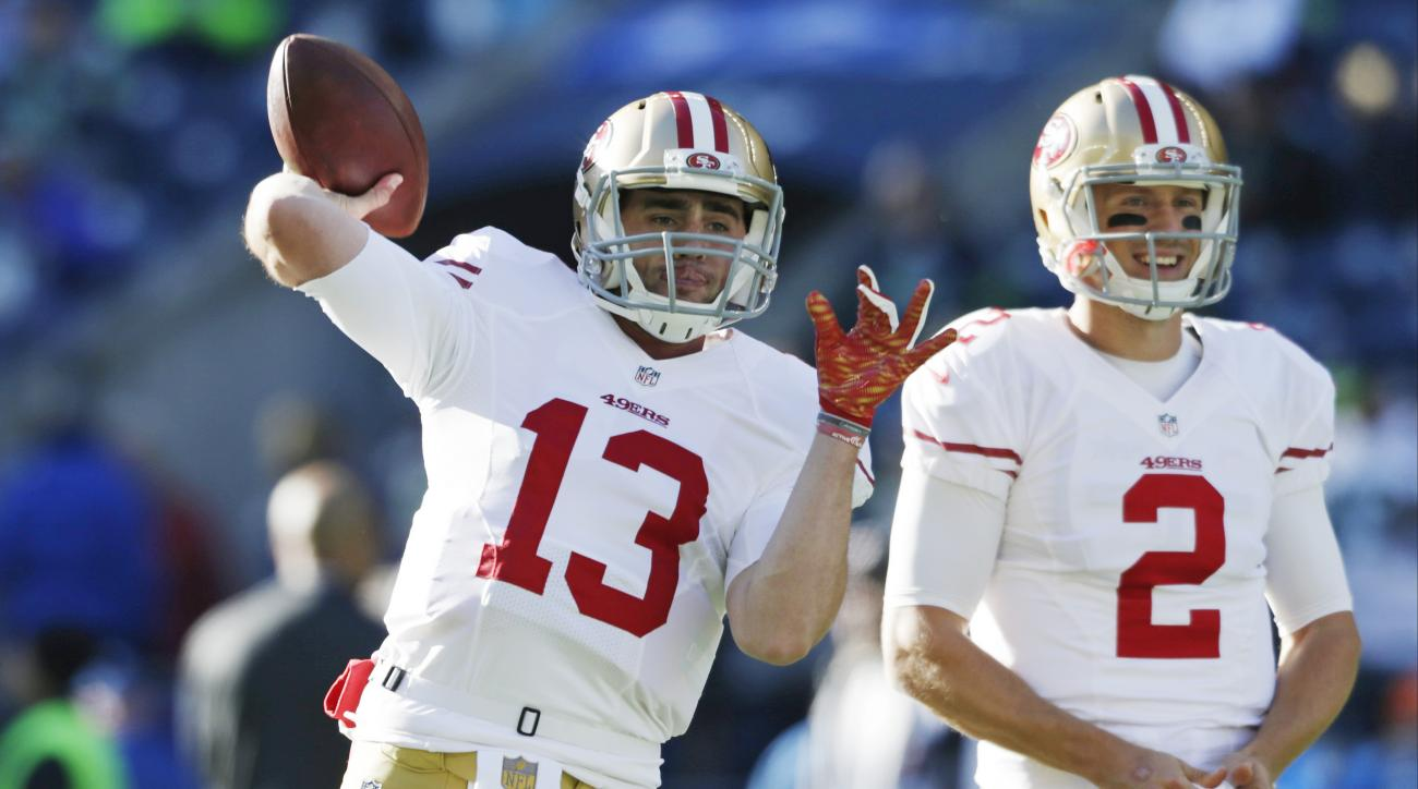 In this Nov. 22, 2015 photo, San Francisco 49ers quarterbacks Dylan Thompson, left and Blaine Gabbert warm up before an NFL football game against the Seattle Seahawks  in Seattle. Thompson has spent the majority of his rookie season as the scout team quar