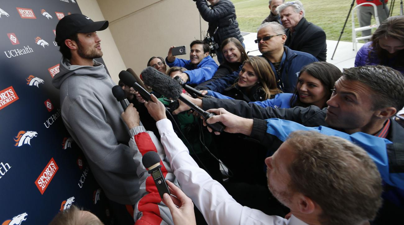 Denver Broncos quarterback Brock Osweiler, left, talks to reporters after an NFL football practice at the team's headquarters Wednesday, Nov. 25, 2015, in Englewood, Colo. (AP Photo/David Zalubowski)