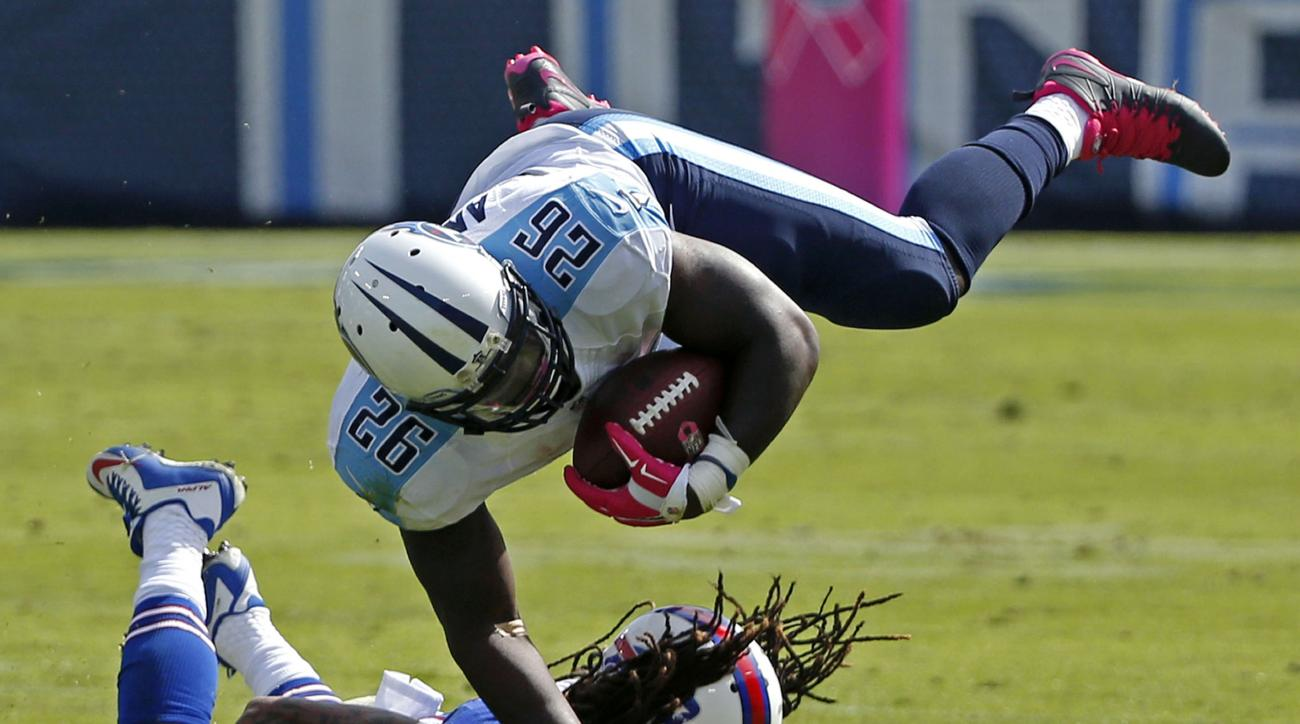FILE - In this Oct. 11, 2015, file photo, Buffalo Bills cornerback Stephon Gilmore (24) upends Tennessee Titans running back Antonio Andrews (26) in the first half of an NFL football game in Nashville, Tenn. Tennessee has not given the home fans something