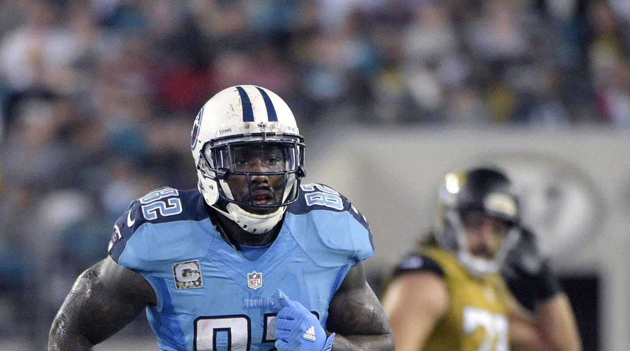 FILE - In this Nov. 19, 2015 file photo, Tennessee Titans tight end Delanie Walker (82) jogs on the field after catching a pass during the first half of an NFL football game against the Jacksonville Jaguars in Jacksonville, Fla.   Walker leads  the Tennes