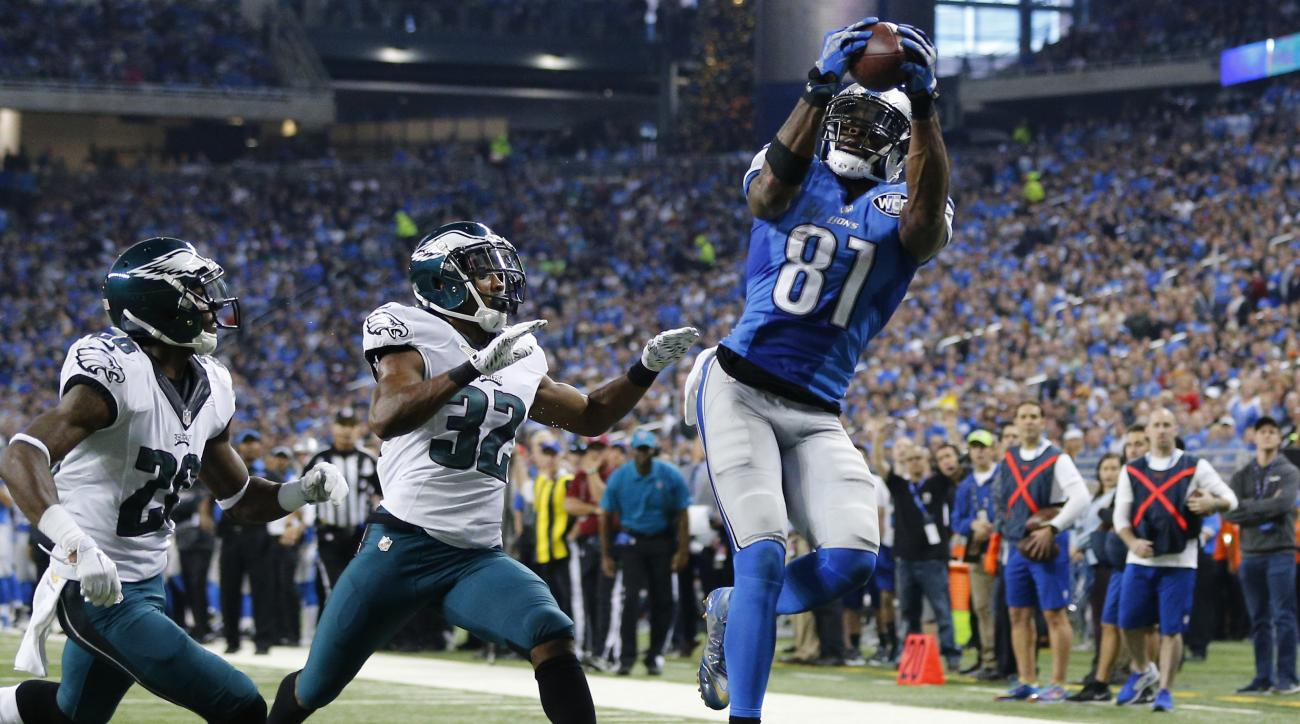 Detroit Lions wide receiver Calvin Johnson (81) catches a 25-yard pass for a touchdown defended by Philadelphia Eagles strong safety Walter Thurmond (26) and cornerback Eric Rowe (32) during the first half of an NFL football game, Thursday, Nov. 26, 2015,