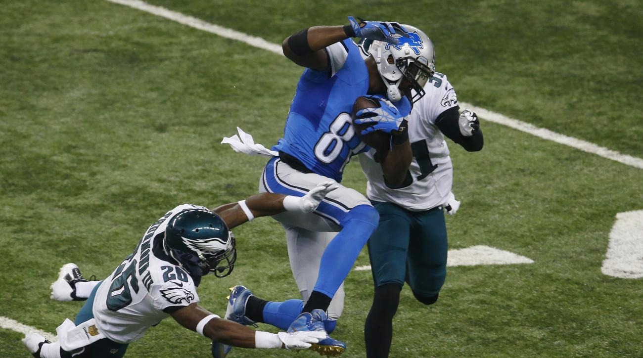 Detroit Lions wide receiver Calvin Johnson (81), defended by Philadelphia Eagles strong safety Walter Thurmond (26) and cornerback Byron Maxwell (31) makes a catch during the first half of an NFL football game, Thursday, Nov. 26, 2015, in Detroit. (AP Pho