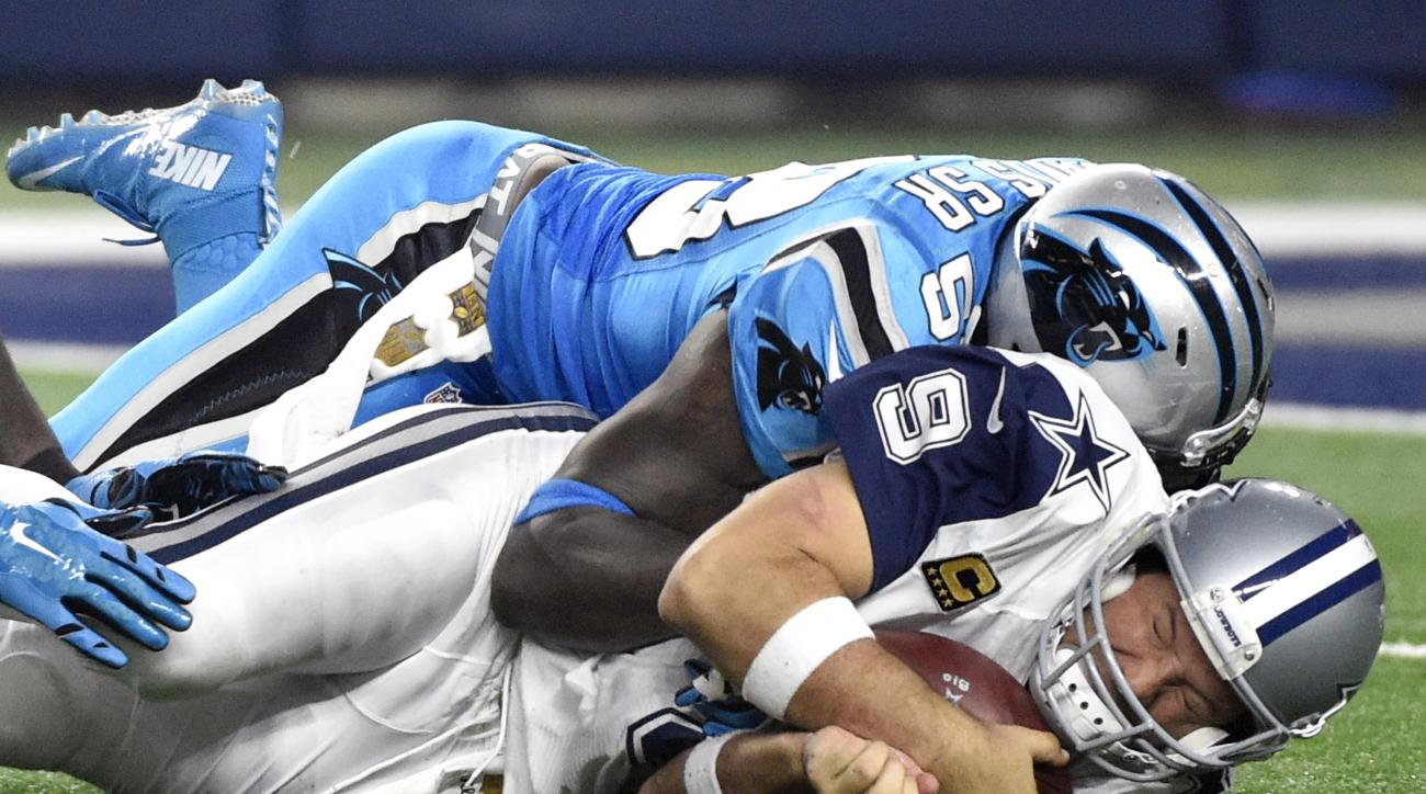 Dallas Cowboys quarterback Tony Romo (9) is sacked by Carolina Panthers outside linebacker Thomas Davis (58) in the second half of an NFL football game, Thursday, Nov. 26, 2015, in Arlington, Texas. Romo was injured on the play and left the game. (AP Phot