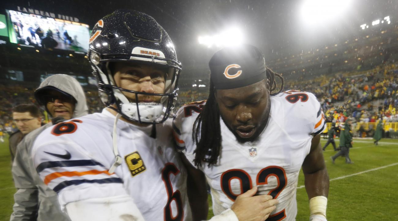 Chicago Bears' Jay Cutler (6) and Pernell McPhee (92) celebrate after an NFL football game against the Green Bay Packers Thursday, Nov. 26, 2015, in Green Bay, Wis. The Bears won 17-13. (AP Photo/Mike Roemer)
