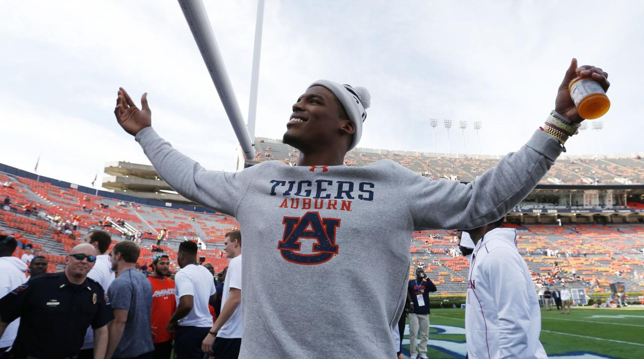 Carolina Panthers quarterback Cam Newton walks onto the Auburn football field before the first half of an NCAA college football game against Alabama, Saturday, Nov. 28, 2015, in Auburn, Ala. (AP Photo/Butch Dill)