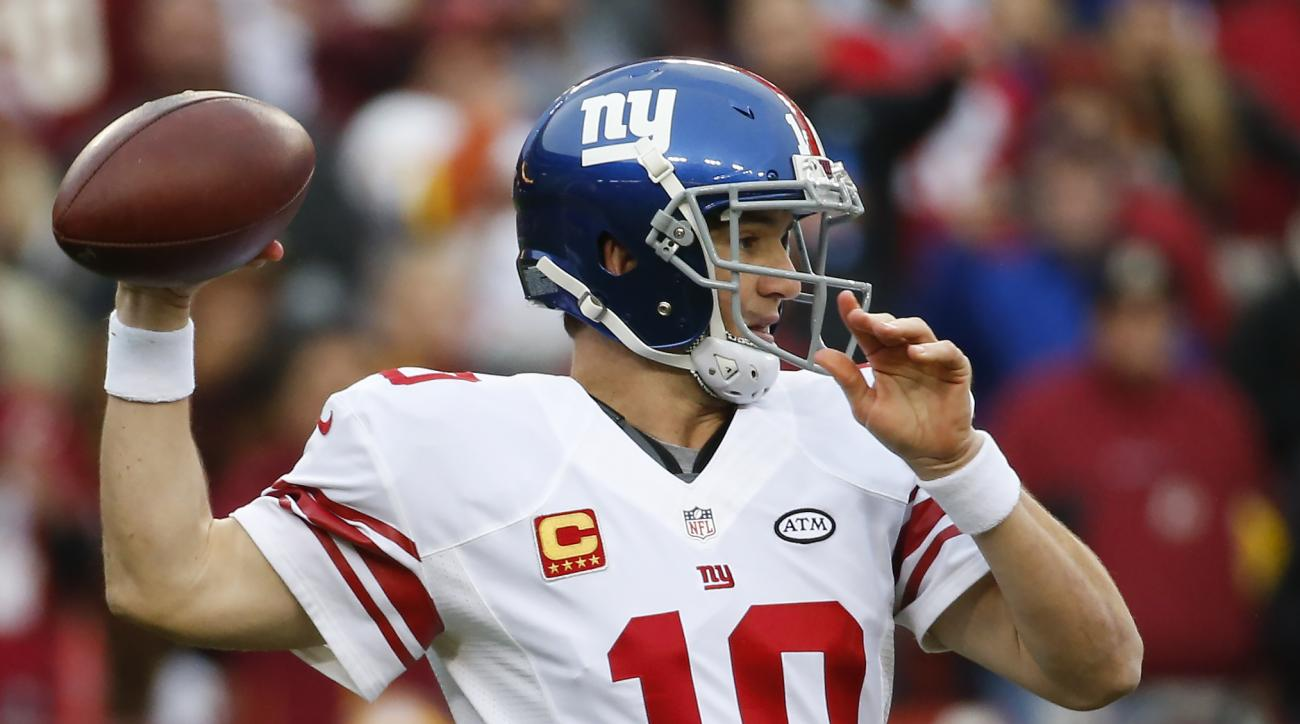 New York Giants quarterback Eli Manning (10) passes the ball during the first half of an NFL football game against the Washington Redskins in Landover, Md., Sunday, Nov. 29, 2015. (AP Photo/Alex Brandon)
