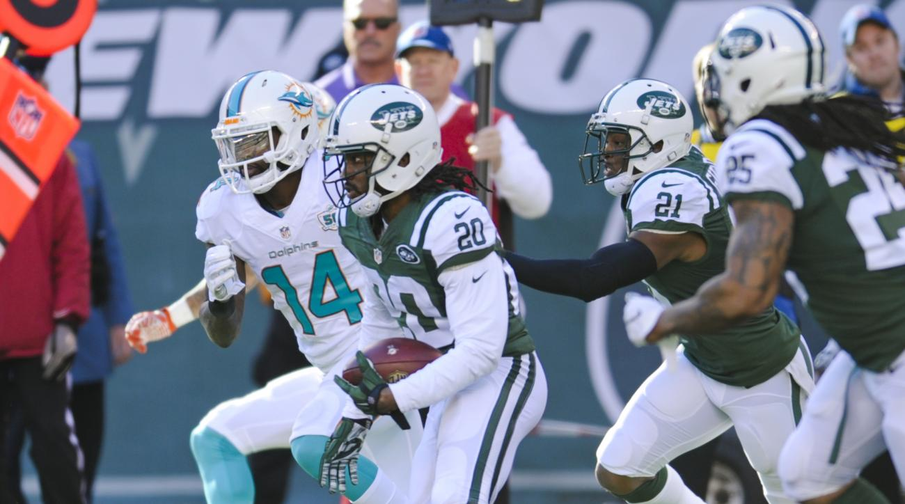 New York Jets strong safety Marcus Williams (20) runs back an interception past Miami Dolphins' Jarvis Landry (14) during the first half of an NFL football game Sunday, Nov. 29, 2015, in East Rutherford, N.J. (AP Photo/Bill Kostroun)