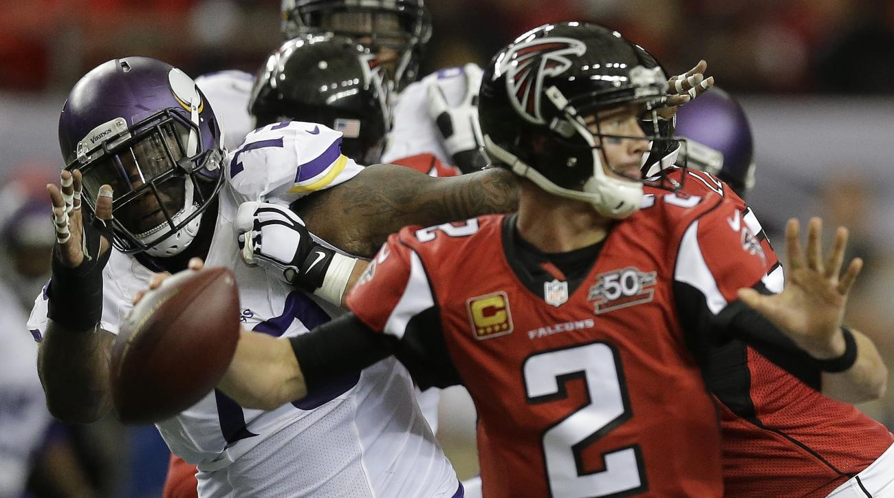 Minnesota Vikings defensive tackle Sharrif Floyd (73) keeps his eye on the ball as Atlanta Falcons quarterback Matt Ryan (2) passes during the first half of an NFL football game, Sunday, Nov. 29, 2015, in Atlanta. (AP Photo/David Goldman)