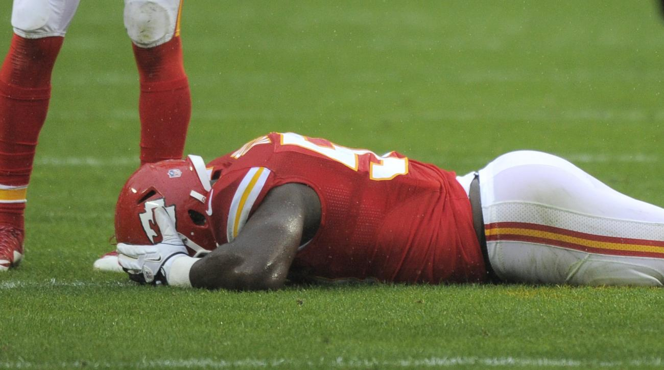 Kansas City Chiefs linebacker Justin Houston (50) lies injured on the field during the first half of an NFL football game against the Buffalo Bills in Kansas City, Mo., Sunday, Nov. 29, 2015. (AP Photo/Ed Zurga)