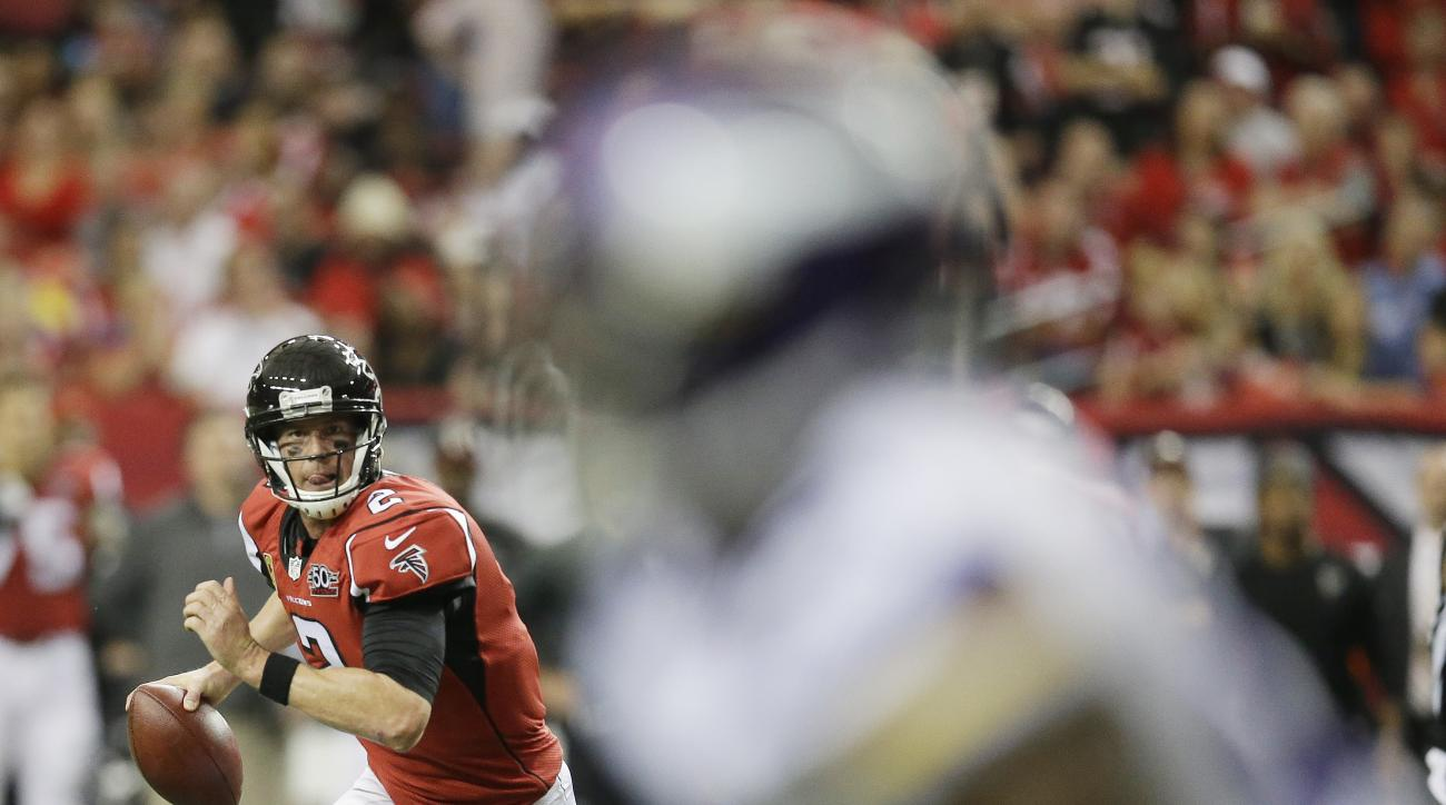 Atlanta Falcons quarterback Matt Ryan (2) runs out of the pocket against the Minnesota Vikings during the second half of an NFL football game, Sunday, Nov. 29, 2015, in Atlanta. (AP Photo/David Goldman)