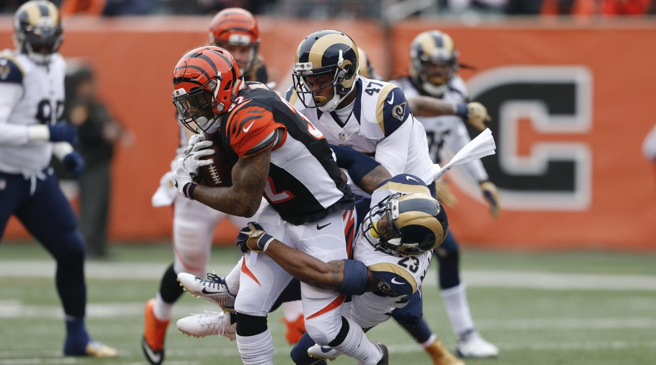 Cincinnati Bengals running back Jeremy Hill (32) is tackled by St. Louis Rams cornerback Marcus Roberson (47) and free safety Rodney McLeod (23) in the first half of an NFL football game, Sunday, Nov. 29, 2015, in Cincinnati. (AP Photo/Gary Landers)