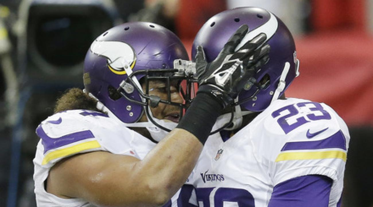 Minnesota Vikings cornerback Terence Newman (23) celebrates his interception with Minnesota Vikings middle linebacker Eric Kendricks (54) against the Atlanta Falcons during the second half of an NFL football game, Sunday, Nov. 29, 2015, in Atlanta. (AP Ph