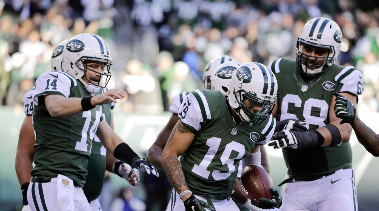 New York Jets quarterback Ryan Fitzpatrick (14) and Breno Giacomini (68) celebrate a touchdown catch by Devin Smith (19) during the first half of an NFL football game against the Miami Dolphins, Sunday, Nov. 29, 2015, in East Rutherford, N.J. (AP Photo/Ju