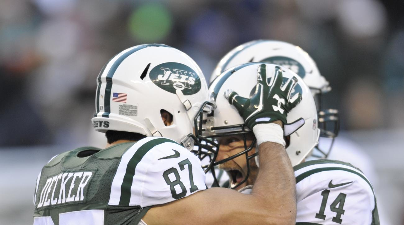 New York Jets quarterback Ryan Fitzpatrick (14) and Eric Decker (87) celebrate after the two connected for a touchdown during the second half of an NFL football game against the Miami Dolphins, Sunday, Nov. 29, 2015, in East Rutherford, N.J. (AP Photo/Bil