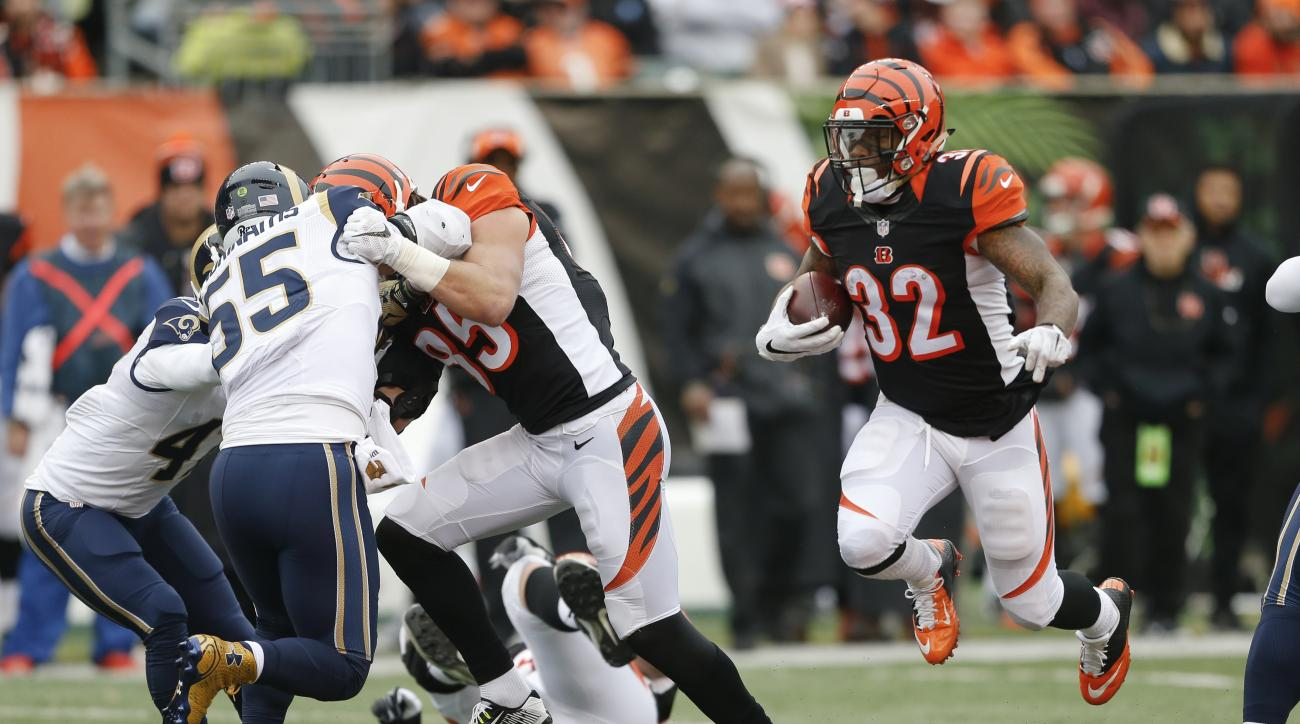 Cincinnati Bengals running back Jeremy Hill (32) runs the ball in the first half of an NFL football game against the St. Louis Rams, Sunday, Nov. 29, 2015, in Cincinnati. (AP Photo/Gary Landers)